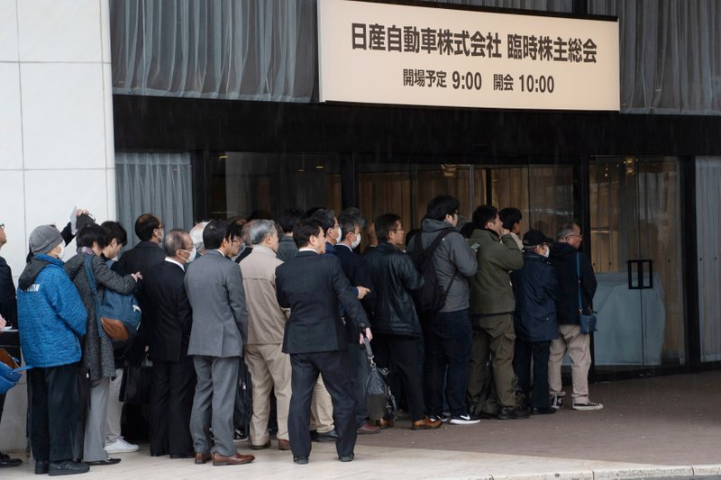 FILE - In this April 8, 2019, file photo released by Nissan Motor Co., Nissan shareholders wait to enter the venue for a meeting in Tokyo. (Nissan Motor Co. via AP, File)