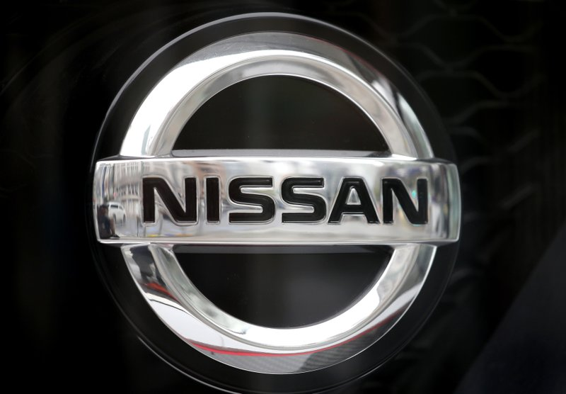 In this April 8, 2019, photo, Nissan logo is seen at the automaker's showroom in Tokyo. Nissan is seeing sales and profits tumble, as its once revered former chairman, Carlos Ghosn, awaits trial on charges of financial misconduct. (AP Photo/Shuji Kajiyama)