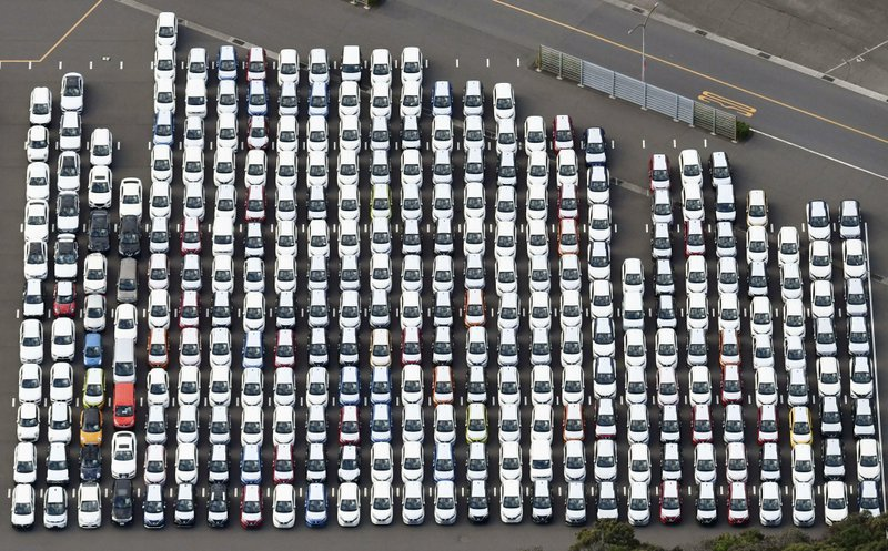 In this Nov. 20, 2018, aerial photo, Nissan Motor cars are seen at the automaker's Oppama plant, in Yokosuka, near Tokyo. (Kyodo News via AP)