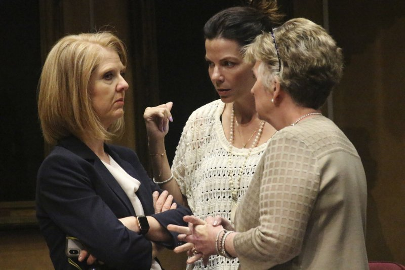 In this April 1, 2019 photo, Arizona Sen. Heather Carter, from left, chats with Sen. Michelle Ugenti-Rita, center, and Sen. (AP Photo/Bob Christie)