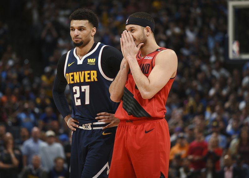 Denver Nuggets guard Jamal Murray, left, looks on as Portland Trail Blazers guard Seth Curry reacts as time runs down in the second half of Game 7 of an NBA basketball second-round playoff series Sunday, May 12, 2019, in Denver. (AP Photo/David Zalubowski)