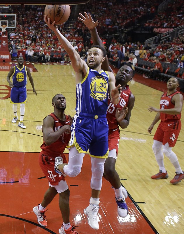 Golden State Warriors guard Stephen Curry (30) drives to the basket as Houston Rockets center Clint Capela (15) defends during the second half of Game 6 of a second-round NBA basketball playoff series, Friday, May 10, 2019, in Houston. (AP Photo/Eric Christian Smith)