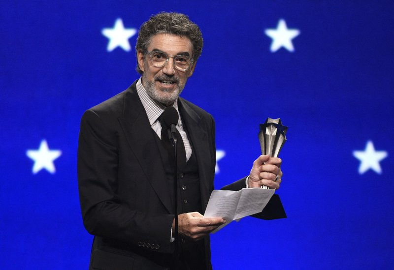 FILE - In this Jan. 13, 2019, file photo, Chuck Lorre accepts the creative achievement award at the 24th annual Critics' Choice Awards at the Barker Hangar in Santa Monica, Calif. (Photo by Chris Pizzello/Invision/AP)