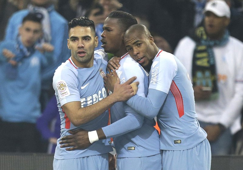 FILE - In this Jan. 28, 2018, photo Monaco's Keita Balde, center, celebrates with Radamel Falcao, left, and Djibril Sidibe after scoring during the League One soccer match between Marseille and Monaco, at the Velodrome Stadium, in Marseille, southern France. (AP Photo/Claude Paris)