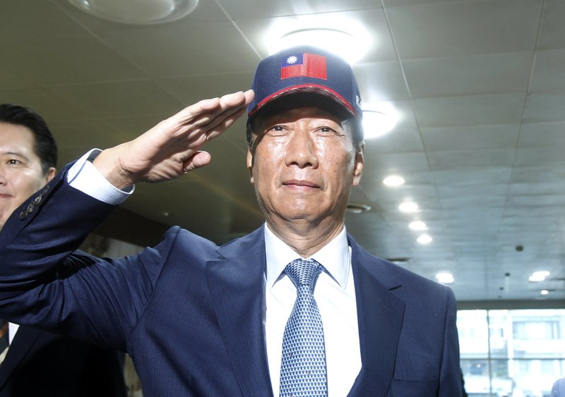 Terry Gou, the head of the world's largest electronics supplier Foxconn, poses for a photo before meeting with Nationalist Party chairman Wu Den-yih at the party headquarters in Taipei, Taiwan, Monday, May 13, 2019. (AP Photo/Chiang Ying-ying)