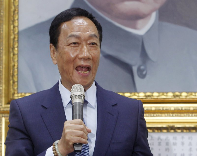 Terry Gou, the head of the world's largest electronics supplier Foxconn, speaks to the media after meeting with Nationalist Party chairman Wu Den-yih at the party headquarters in Taipei, Taiwan, Monday, May 13, 2019. (AP Photo/Chiang Ying-ying)
