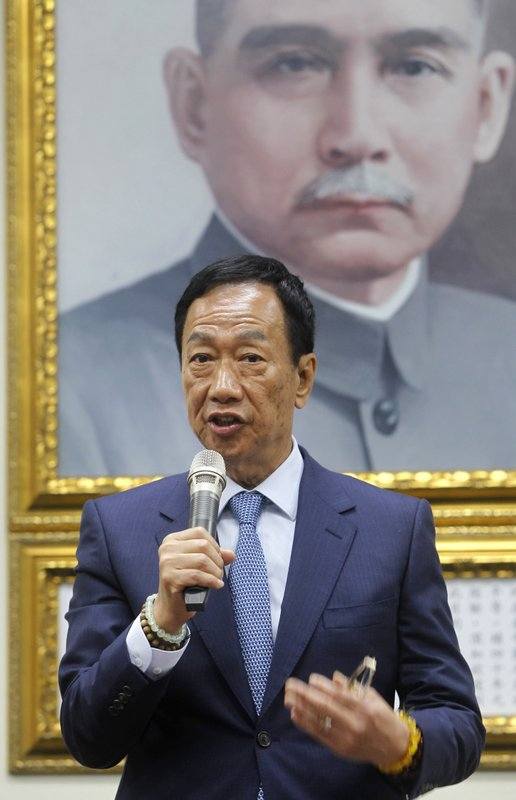 Terry Gou, the head of the world's largest electronics supplier, Foxconn, answers to media after meeting Nationalist Party''s chairman Wu Den-yih at the Nationalist Party''s headquarters in Taipei, Taiwan, Monday, May 13, 2019. (AP Photo/Chiang Ying-ying)