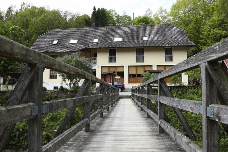 A guesthouse is pictured at the river 'Ilz' in Passau, Germany, Monday, May 13, 2019. Police investigating the mysterious death of three people whose bodies were found with crossbow bolts inside at the hotel in Bavaria on Saturday, May 11, 2019. (AP Photo/Matthias Schrader)