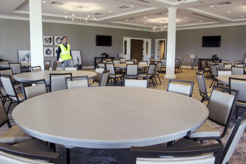 This May 8, 2019 photo, Nathan Grube, tournament director of the Travelers Championship, examines a ballroom in the new clubhouse at TPC River Highands in Cromwell, Conn. (AP Photo/Pat Eaton-Robb)