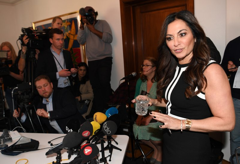 Elisabeth Massi Fritz, the lawyer representing a woman who alleges that she was raped by Julian Assange, holds a press conference in Stockholm, Sweden, Monday May 13, 2019. (Fredrik Sandberg/TT via AP)