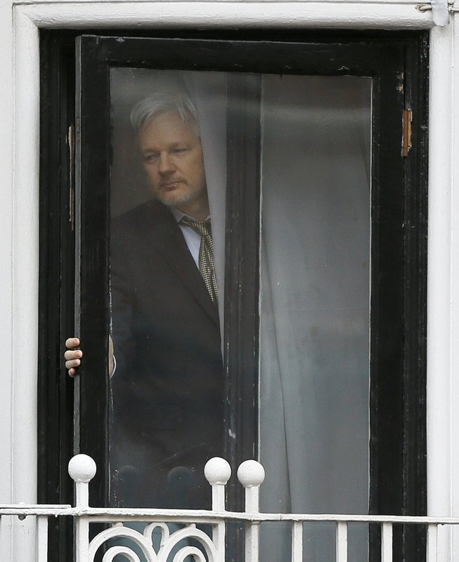 FILE - In this file photo dated Friday, Feb. 5, 2016, Wikileaks founder Julian Assange steps onto the balcony of the Ecuadorean Embassy in London, preparing to address supporters and the media. (AP Photo/Kirsty Wigglesworth, File)