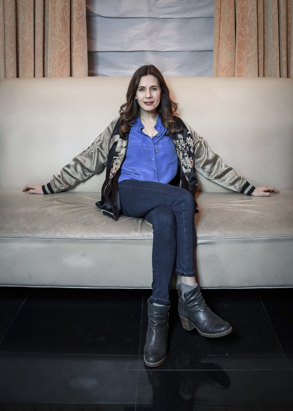 This April 24, 2019 photo shows actress Jessica Hecht posing for a portrait at the JW Marriott Essex House in New York to promote her Netflix series