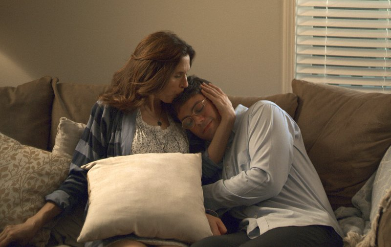 This image released by Netflix shows Jessica Hecht, left, and Ryan O'Connell in a scene from the series