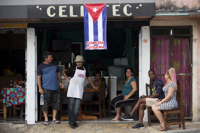In this April 28, 2019 photo, Cuban migrants gather at a diner