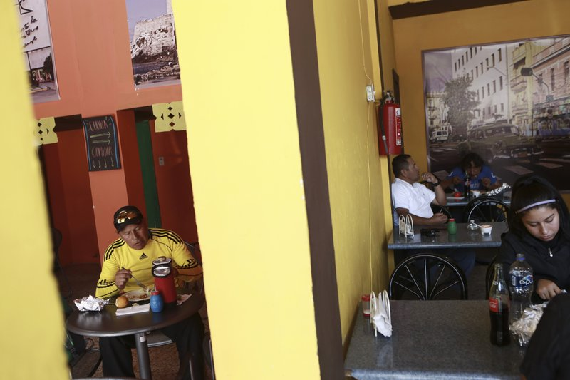 In this April 25, 2019, photo, customers eat lunch in Little Habana restaurant in Ciudad Juarez, Mexico. (AP Photo/Christian Torres)