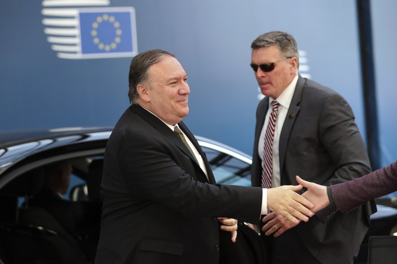U.S. Secretary of State Mike Pompeo, left, arrives for a meeting with European foreign ministers at the Europa building in Brussels, Monday, May 13, 2019. (AP Photo/Francisco Seco)