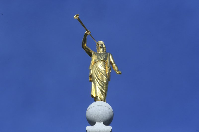 FILE - In this April 6, 2019, file photo, the angel Moroni statue sits atop the Salt Lake City temple, in Salt Lake City. (AP Photo/Rick Bowmer, File)