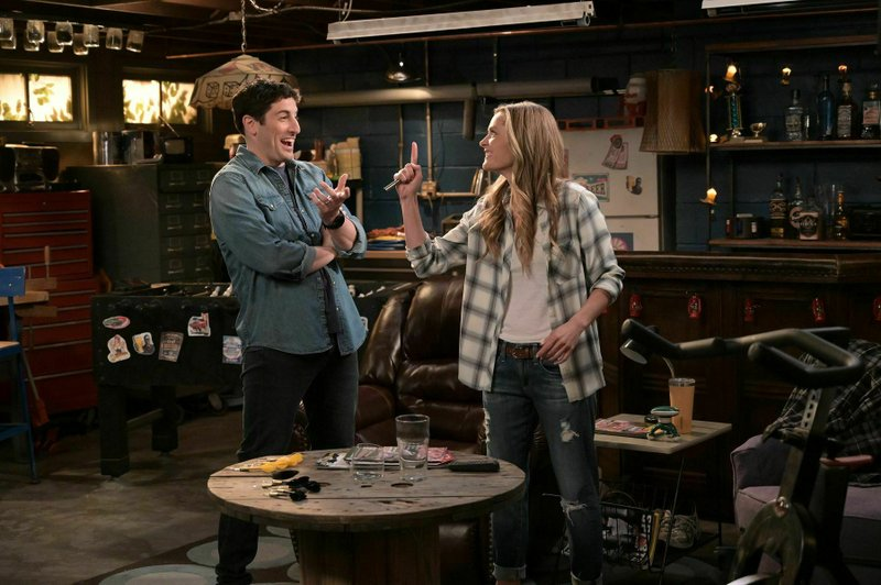 """This image provided by Fox Broadcasting Co. on Monday, May 13, 2019, shows Jason Biggs and Maggie Lawson in a scene from the network's upcoming comedy """"Outmatched."""" The show is one of several new additions to Fox's prime-time lineup and the network describes it as a sitcom in which Biggs and Lawson are a blue-collar couple raising four kids, three of whom are geniuses. (Michael Becker/FOX via AP)"""