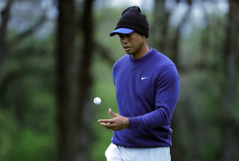 Tiger Woods flips his ball as he walks along the ninth green during a practice round for the PGA Championship golf tournament, Monday, May 13, 2019, in Farmingdale, N. (AP Photo/Julie Jacobson)