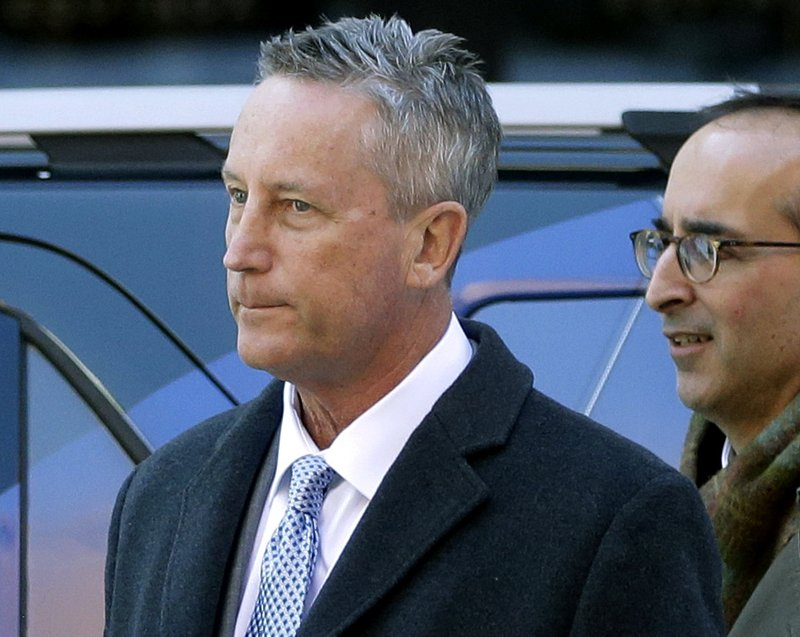 FILE - In this March 12, 2019 file photo, Martin Fox, from a private tennis academy in Houston, arrives at federal court in Boston to face charges in a nationwide college admissions bribery scandal. (AP Photo/Steven Senne, File)