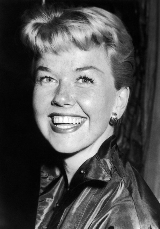 FILE - In this April 12, 1955 file photo, film actress and singer Doris Day smiles in London. Day, whose wholesome screen presence stood for a time of innocence in '60s films, has died, her foundation says. (AP Photo/Bob Dear, File)