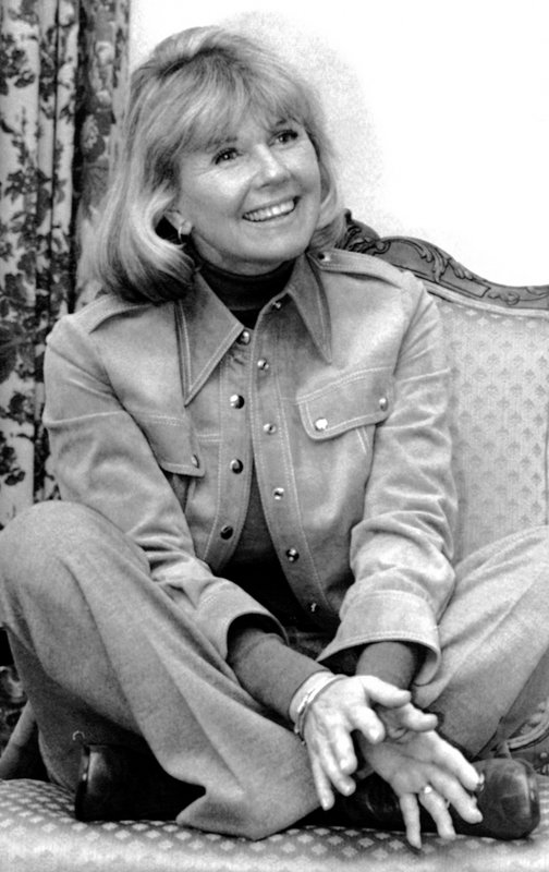 FILE - In this Jan. 6, 1976 file photo, actress and singer Doris Day answers questions in New York, during an interview on the book