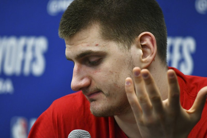 Denver Nuggets center Nikola Jokic speaks after the second half of Game 7 of an NBA basketball second-round playoff series Sunday, May 12, 2019, in Denver. The Trail Blazers won 100-96. (AP Photo/John Leyba)
