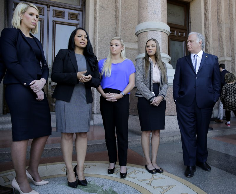 Tasha Schwikert, second from left, with other former gymnasts Amy Baumann, center, and Jordan Schwikert, second from right, and Texas state Sen. (AP Photo/Eric Gay)