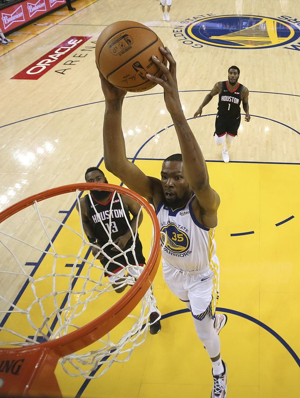 Golden State Warriors' Kevin Durant (35) scores over Houston Rockets' James Harden (13) during the first half of Game 5 of a second-round NBA basketball playoff series Wednesday, May 8, 2019, in Oakland, Calif. (Ezra Shaw/Pool Photo via AP)