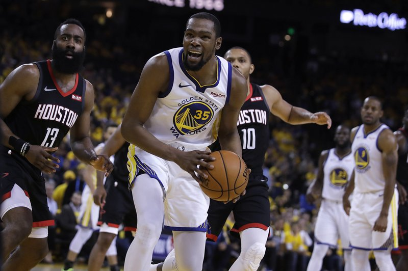Houston Rockets' James Harden, left, and Golden State Warriors' Kevin Durant (35) react to a referee's call during the second half of Game 5 of a second-round NBA basketball playoff series Wednesday, May 8, 2019, in Oakland, Calif. (AP Photo/Ben Margot)