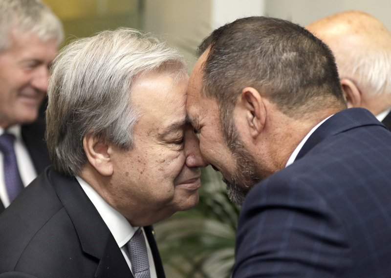 United Nations Secretary-General, Antonio Guterres, left, receives a hongi from Arapata Reuben on his arrival at a climate change and agriculture event hosted by Ngai Tahu iwi and the Global Research Alliance on Agricultural Greenhouse Gases in Christchurch, New Zealand, Tuesday, May 14, 2019. (AP Photo/Mark Baker,Pool)