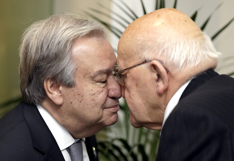 United Nations Secretary-General Antonio Guterres, left, receives a hongi from Sir Tipene O'Regan upon his arrival at a climate change and agriculture event hosted by Ngai Tahu iwi and the Global Research Alliance on Agricultural Greenhouse Gases in Christchurch, New Zealand, Tuesday, May 14, 2019. (AP Photo/Mark Baker, Pool)