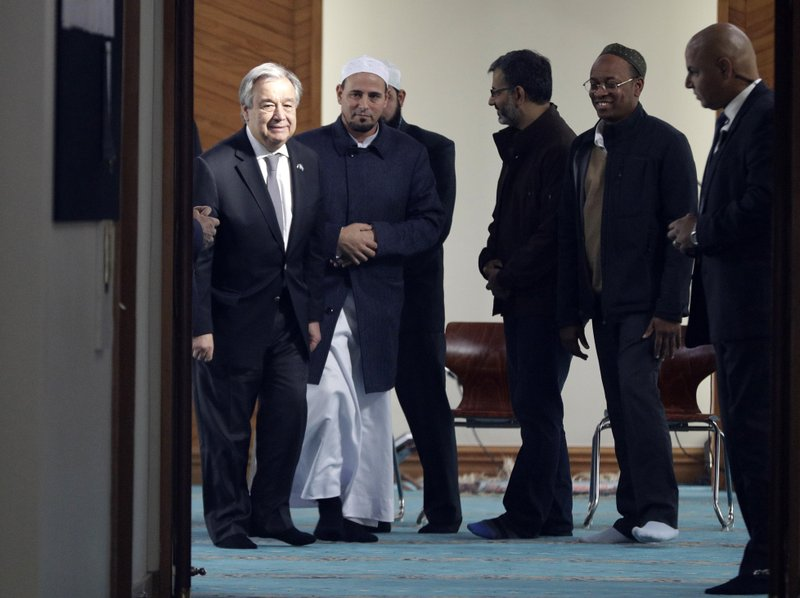 United Nations Secretary-General Antonio Guterres, left, walks with Al Noor mosque Imam Gamal Fouda, second from left, during a visit to the mosque in Christchurch, New Zealand, Tuesday, May 14, 2019. (AP Photo/Mark Baker)