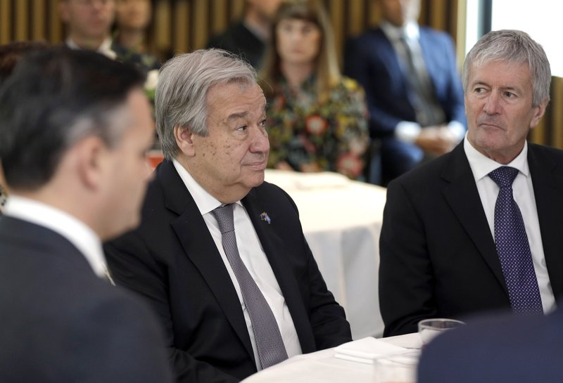 United Nations Secretary-General António Guterres, center, sits with cabinet minister Damien O'Connor, right, during a climate change and agriculture event hosted by Ngai Tahu iwi and the Global Research Alliance on Agricultural Greenhouse Gases in Christchurch, New Zealand, Tuesday, May 14, 2019. (AP Photo/Mark Baker,Pool)