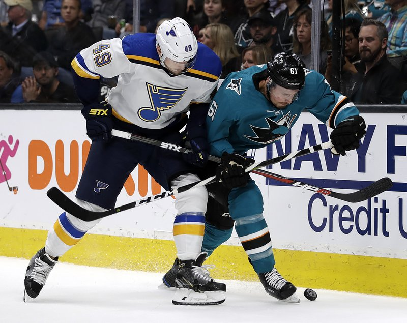 St. Louis Blues' Ivan Barbashev, left, and San Jose Sharks' Justin Braun fight for the puck during the second period in Game 2 of the NHL hockey Stanley Cup Western Conference finals Monday, May 13, 2019, in San Jose, Calif. (AP Photo/Ben Margot)