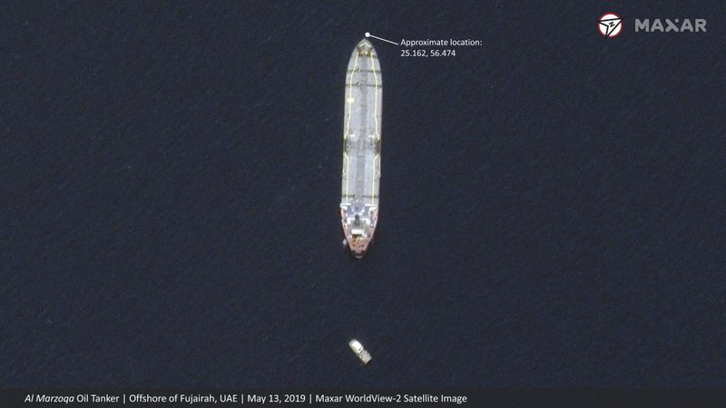This satellite image provided by Maxar Technologies shows the Saudi-flagged oil tanker Al Marzoqa off the coast of Fujairah, United Arab Emirates, Monday, May 13, 2019. (Satellite image ©2019 Maxar Technologies via AP)