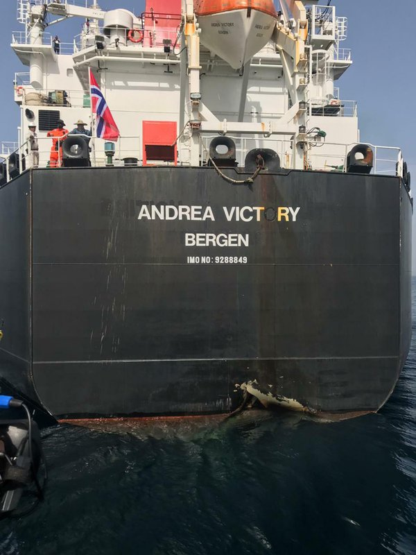 This photo provided by the United Arab Emirates' National Media Council shows the Norwegian-flagged oil tanker MT Andrea Victory off the coast of Fujairah, United Arab Emirates, Monday, May 13, 2019. (United Arab Emirates National Media Council via AP)