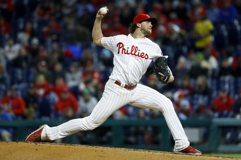 Philadelphia Phillies' Aaron Nola pitches during the third inning of a baseball game against the Milwaukee Brewers, Monday, May 13, 2019, in Philadelphia. (AP Photo/Matt Slocum)