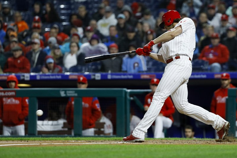 Philadelphia Phillies' Aaron Nola follows through on his at-bat against the Milwaukee Brewers during the second inning of a baseball game, Monday, May 13, 2019, in Philadelphia. (AP Photo/Matt Slocum)
