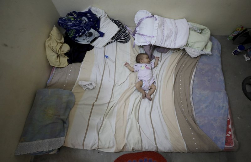 Two-month-old daughter Zuleidy Primera sleeps at her family's home in Cucuta, Colombia, Thursday, May 2, 2019. (AP Photo/Fernando Vergara)