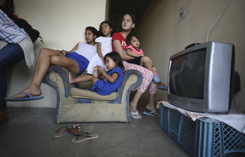 Siblings and cousins newly born Zuleidys Antonella Primera, sit in the living room of their home in Cucuta, Colombia, Thursday, May 2, 2019. (AP Photo/Fernando Vergara)