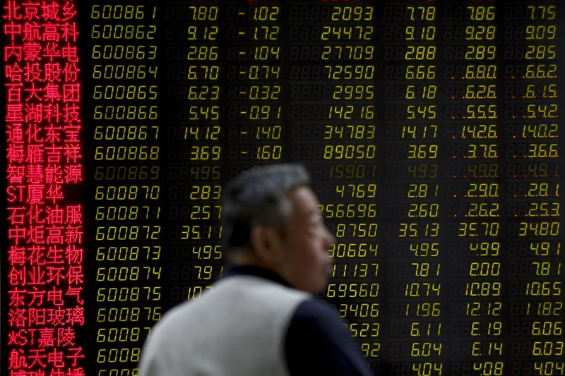 A man reacts as he monitors stock prices at a brokerage house in Beijing, Tuesday, May 14, 2019. Shares opened moderately lower in Asia on Tuesday after a dismal day on Wall Street as investors fled uncertainty over the China-U. (AP Photo/Andy Wong)