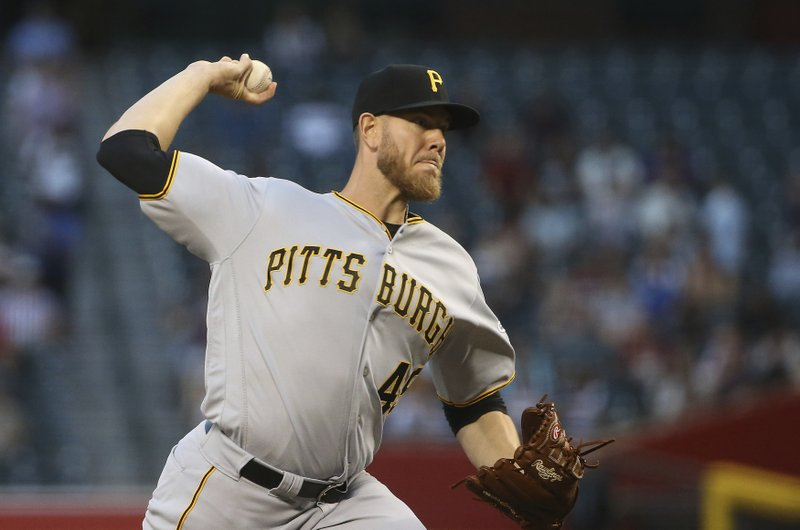 Pittsburgh Pirates starting pitcher Nick Kingham throws against the Arizona Diamondbacks during the first inning of a baseball game Monday, May 13, 2019, in Phoenix. (AP Photo/Ross D. Franklin)