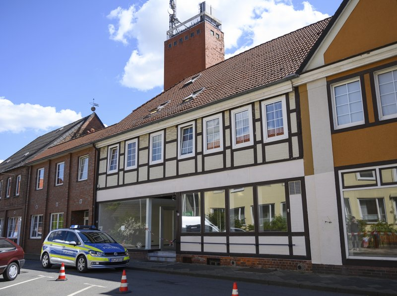 A police car stands in front of a building where the bodies of two women have been found at an apartment, in Wittlingen, northern Germany, Monday, May 13, 2019. (Christophe Gateau/dpa via AP)