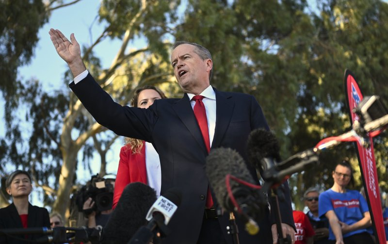 Australian Labour Party leader Bill Shorten, center, speaks to volunteers during a community barbecue in Adelaide, Australia Tuesday, May 14, 2019. (Lukas Coch/AAP Image via AP)