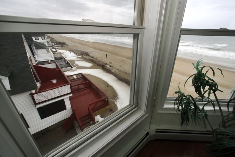 This Feb. 15, 2019 photo shows a view out the window of an oceanfront condo in Salisbury, Mass. Academic researchers say concerns over rising sea levels and increased flooding are having subtle but significant impacts on coastal property values, finding that climate change concerns have sapped more than $15 billion in appreciation from homes along the Eastern Seaboard and Gulf Coast. (AP Photo/Elise Amendola)