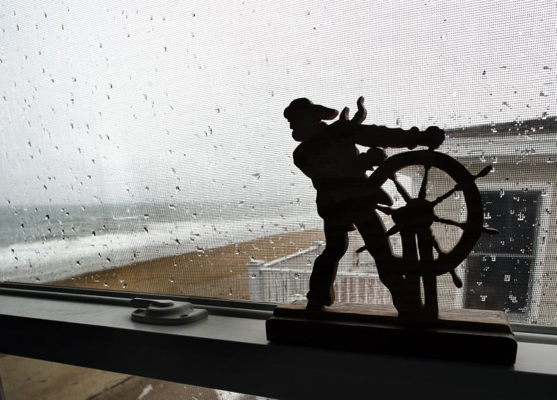 This Feb. 15, 2019 photo shows a view out the window of an oceanside condo in Salisbury, Mass. Academic researchers say concerns over rising sea levels and increased flooding are having subtle but significant impacts on coastal property values, finding that climate change concerns have sapped more than $15 billion in appreciation from homes along the Eastern Seaboard and Gulf Coast. (AP Photo/Elise Amendola)