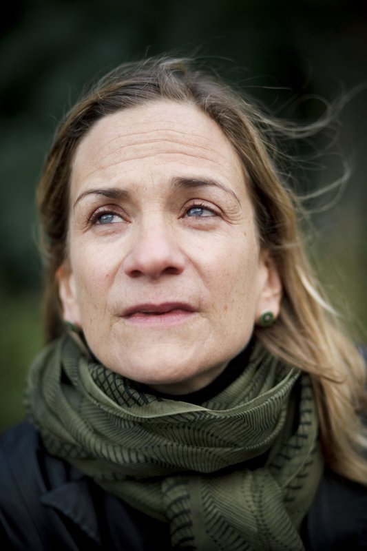 FILE- In this Friday, Nov. 27, 2009 file photo, American author Tracy Chevalier poses for photographs in central London. (AP Photo/David Azia, File)