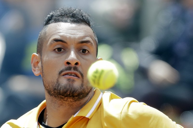Nick Kyrgios of Australia returns the ball to Daniil Medvedev of Russia at the Italian Open tennis tournament, in Rome, Tuesday, May, 14, 2019. (AP Photo/Andrew Medichini)