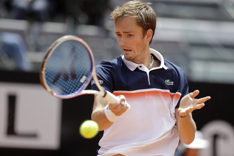 Daniil Medvedev of Russia returns the ball to Nick Kyrgios of Australia at the Italian Open tennis tournament, in Rome, Tuesday, May, 14, 2019. (AP Photo/Andrew Medichini)